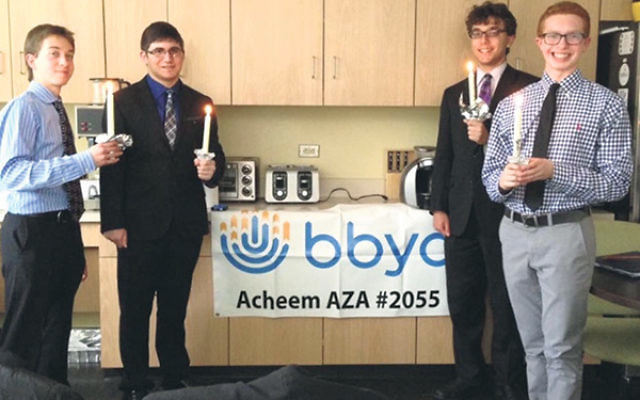Tyler Bardfeld, second from left, was elected to a board position for Acheem AZA #2055 along with, from left, Sam Gritz, Spencer Szwalbenest, and Brett Hoffman.