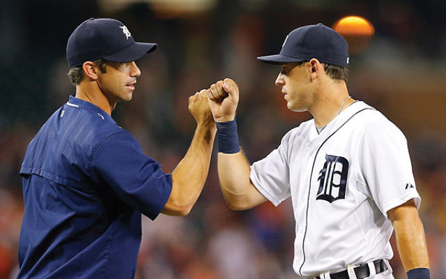 Detroit Tigers manager Brad Ausmus, left, and second baseman Ian Kinsler celebrating a win over the Seattle Mariners at Comerica Park in Detroit, July 20, 2015. They are two of the most prominent Jews in the majors this year. Leon Halip/Getty Images