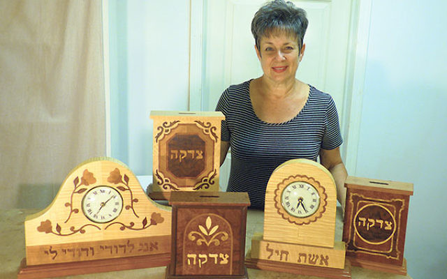 Bella Scharf shows a display of the marquetry items she made in her workshop in Marlboro.