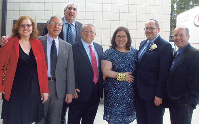 Arriving at the dinner dance are, from left, dinner committee member Mara Sacks, Beth El president Marc Hilton, committee members Darryl Jayson and Rick Weitz, Naomi Lasky, Rabbi Eli Garfinkel, and dinner chair Scott Fink.