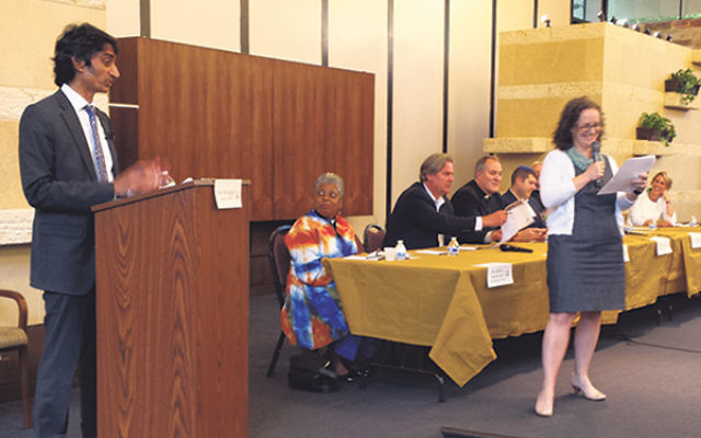 Arun Venugopal, left, and Marcy Felsenfeld welcome an interfaith panel of clergy members at a North Jersey Pride Week event at Congregation Beth El on June 8.