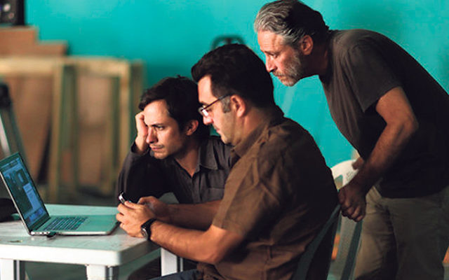 Maziar Bahari, center, Jon Stewart, right, and Gael Garcia Bernal, who plays Bahari, during the filming of Rosewater in 2013 in Amman, Jordan; the movie opened Nov. 14,