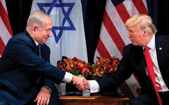 Prime Minister Netanyahu and President Trump shake hands before a meeting at the Palace Hotel during the 72nd session of the United Nations General Assembly. Brendan Smialowski/AFP/ Getty Images