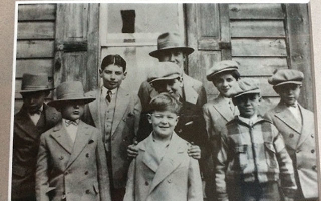 A B'nai Abraham rabbi (name unknown) and students circa 1929 in front of the temple. Norman Goldman, front row at left, is the father of current member Bonnie Goldman. Courtesy Bonnie Goldman