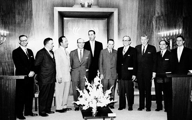 B'nai Or leaders gather on the bima for the dedication in 1958 of the temple's original building on South Street, built on land donated by former Morristown Mayor W. Parsons Todd, fifth from right.