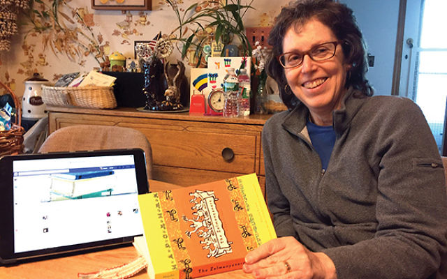 "Susan Winter of Highland Park with, ""The Zelmenyaners: A Family Saga,"" the first selection in a national book group launched in January by the National Yiddish Book Center. Photo courtesy Susan Winter"