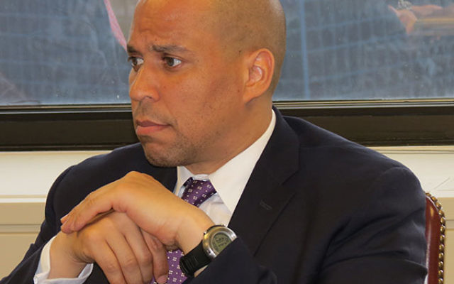 Seated at the head of the table at his Newark office, Sen. Cory Booker (D-NJ) considered suggestions from some of New Jersey's key Jewish leaders.
