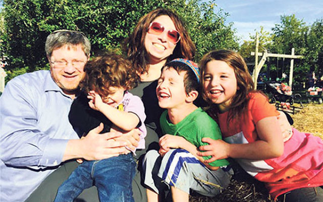 """Rabbi Maury Kelman, Agudath Achim's new religious leader, with his wife, Peninah, and their children. """"We hope that everyone who enters our shul will feel comfortable and welcome,"""" he said."""