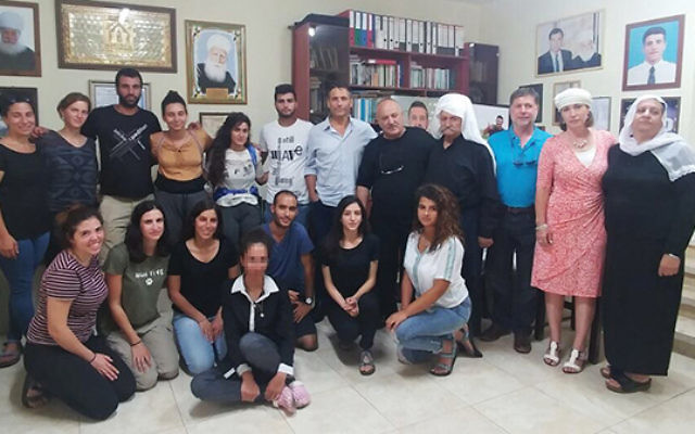 Participants of Achi Israeli pay respects to the Shnaan family in their Druze village of Horfesh. One participant, Raya, is the sister of Israeli police officer Kamil Shnaan, who was murdered by a Palestinian terrorist while standing guard in the Old City
