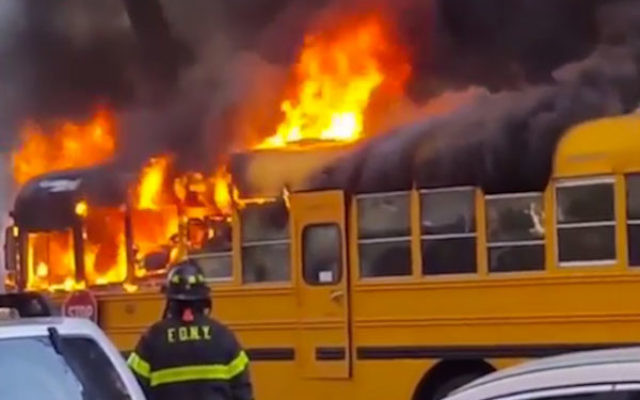A school bus outside a Jewish school burning in the Crown Heights area of Brooklyn, N.Y., May 8, 2016. (Screenshot from YouTube)