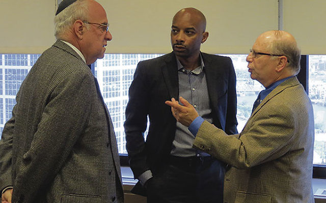 Max Kleinman, executive vice president of Jewish Federation of Greater MetroWest, right, confers with Mo Butler, center, and Gordon Haas after the meeting.