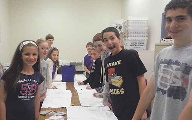 At a May 14 pre-camp get-together, One Happy Camper grant recipients decorate pillowcases, which they will take to camp.