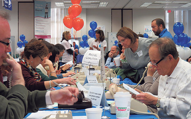 Volunteers man the phones at the Greater MetroWest federation's annual UJA phonathon and fund-raiser last December.