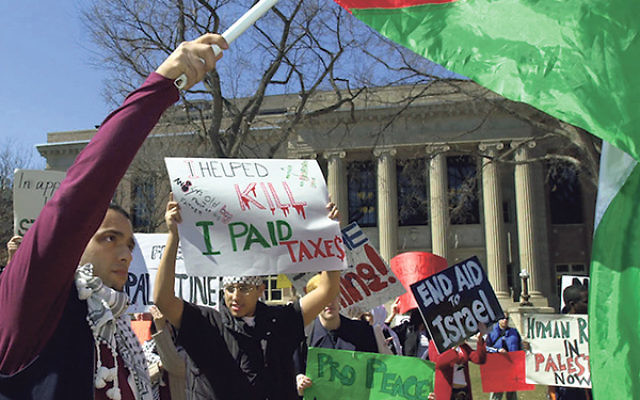Students at the University of Minnesota waving a Palestinian flag and holding pro-Palestinian banners during a protest at the school's Minneapolis campus.