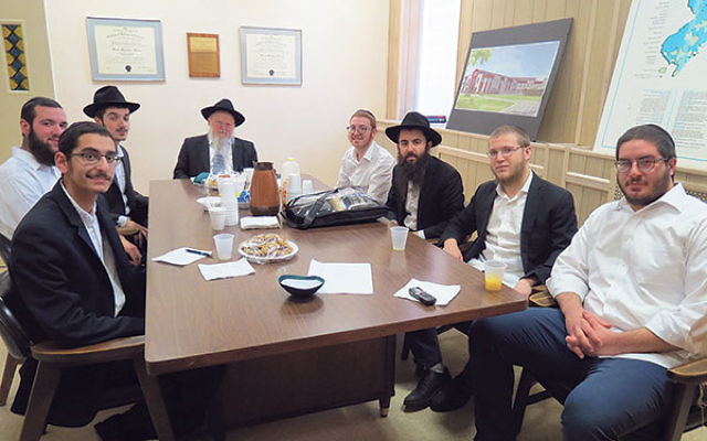 Discussing their Pesach travels at the Rabbinical College of America are, from left, Dovid Zaltzman, Shneur Wolf, Aryeh Herson, Dean Rabbi Moshe Herson, Laizer Mangel, Avrohom Kener, Eliezur Shur, and Shalom Dubov.