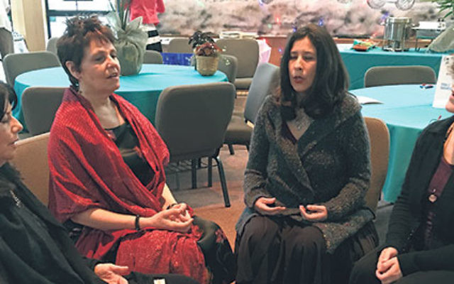 The founders and core of the sacred chanting circle at Bnai Keshet in Montclair, from left, Sharon Freedman, Beth Sandweiss, Deborah Zafman, and Melissa Schaffer.