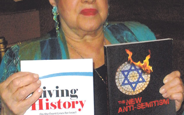 "Phyllis Chesler, holding two of her books, said after decades of leadership in the feminist movement she has been ""disappeared"" because of her stance on Israel."