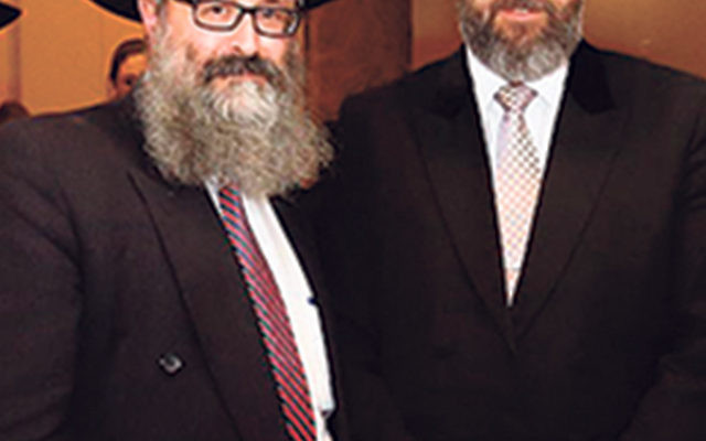 Rabbi David Lau, the chief Ashkenazi rabbi of Israel, right, is greeted by Rutgers Chabad executive director Rabbi Yosef Carlebach.