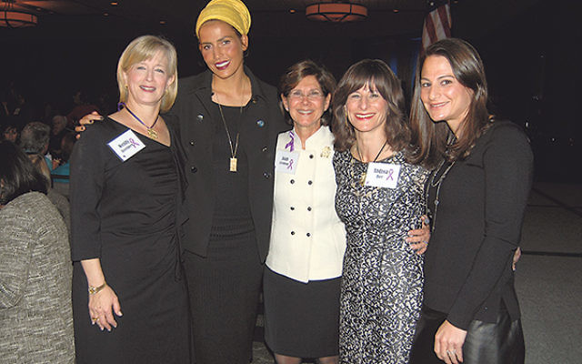 Former Miss Israel and Miss World Linor Abargil, second from left, is welcomed to the event by Women's Campaign president Joan Levinson, middle, and Choices chairs, from left, Wendy Rosenberg and Andrea Bier and committee member Rachel Fink.