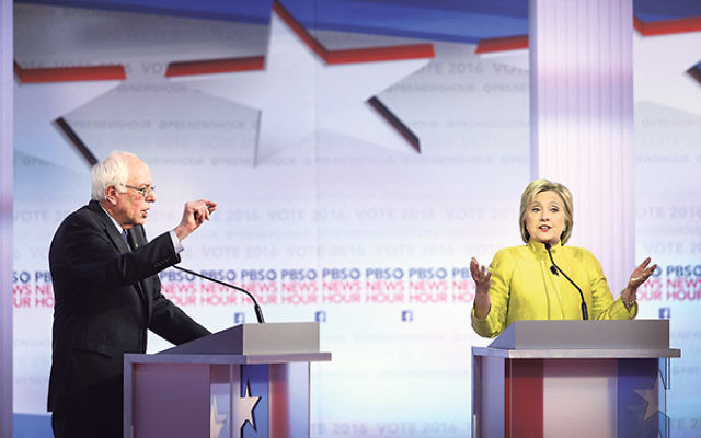 Bernie Sanders and Hillary Clinton participating in the PBS NewsHour Democratic presidential debate at the University of Wisconsin-Milwaukee, Feb. 11.