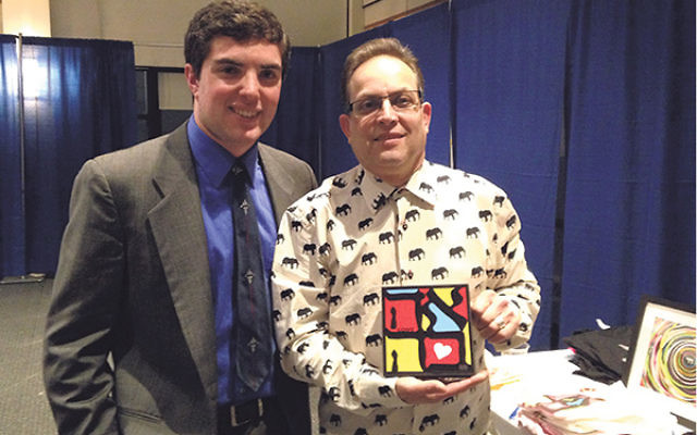 Jonas Singer, left, with Boaz Kimmelman, founder of the Millburn-based WordPlay Graphics, a company that produces Hebrew-inspired Judaica and gifts, at the second annual BIPAC Israel Invents internship fair on Jan. 29.