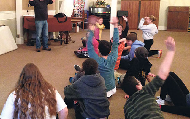 Temple Sholom congregant and comedian Alex Bernstein teaches youngsters how to do improvisation and stand-up, as part of the temple's summer program.