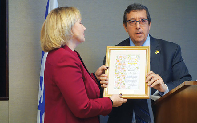 "Lt. Gov. Kim Guadagno receives a ""Woman of Valor"" plaque from Mark Levenson, chair of the New Jersey-Israel Commission. Photo by Robert Wiener"
