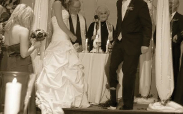Melissa Renny and Chris Schrader at their wedding in 2008. Photo Courtesy EZ Memories