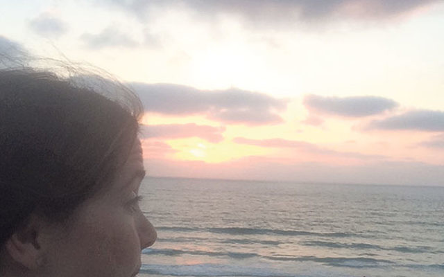 Madelaine Ellberger observes sunset in Netanya after spending time with soldiers and bereaved families during a four-day visit to Israel.