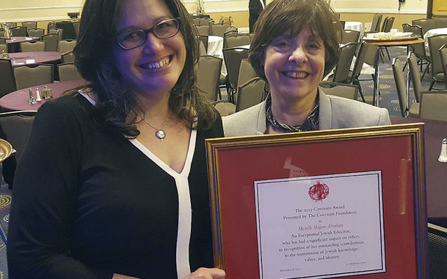 Michelle Shapiro-Abraham, left, displays her Covenant Award for Excellence in Jewish Education with Temple Sholom past president Sandra Nussenfeld, who submitted the nomination.