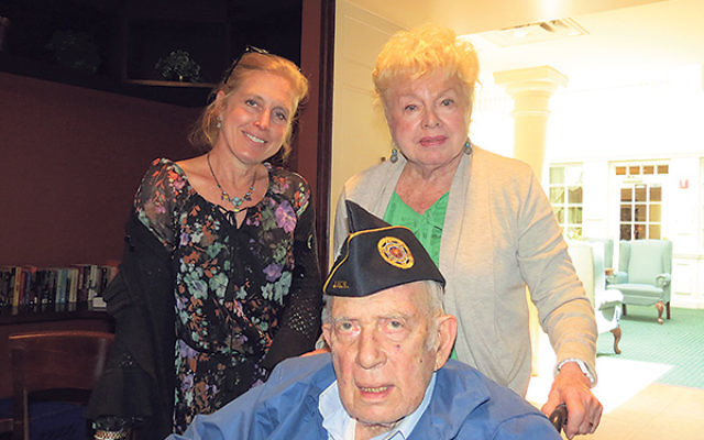 Harry Zaslow shares memories of World War II anti-Semitism with his wife, Naomi, and daughter, Lisa Zaslow Segelman.