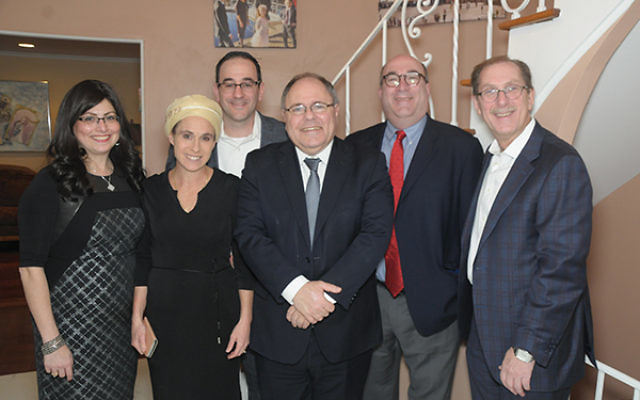 Consul General Dani Dayan, center, is flanked by West Orange One Israel Fund supporters and to his left, Natalie Sopinsky, director of community development. They are with, from left, Renee and Moshe Glick, One Israel Fund President Jonathan Sherman, and