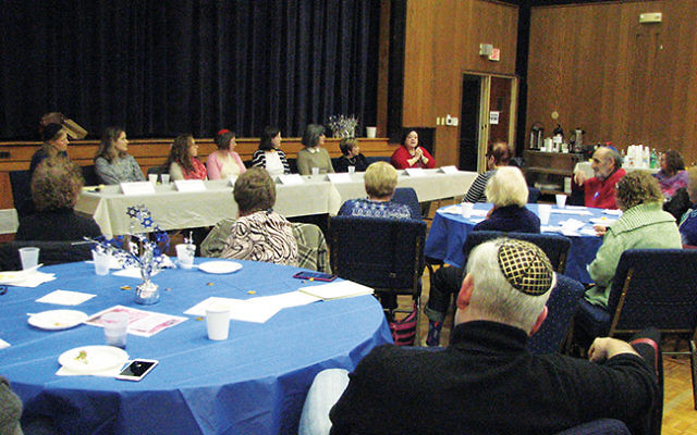 A panel of women, including Rabbi Rachel Schwartz, left, at Temple Beth-El Mekor Chayim in Cranford, talked about how they negotiate an interfaith family holiday season. Photo by Johanna Ginsberg