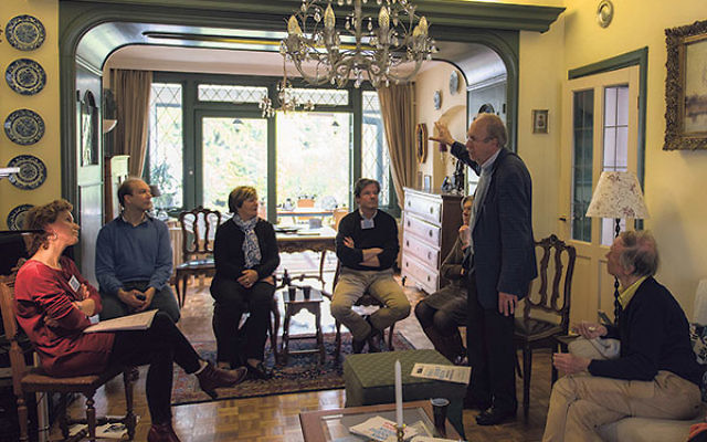 Kees van den Heuvel, standing, talking to guests about the Jewish family that once lived in what is now his home in the Netherlands town of Vught, April 30.