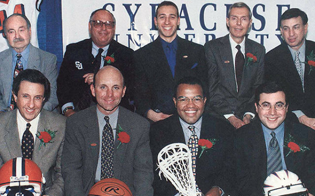 Ian Eagle, bottom row, right, and Marty Glickman, top row, left, were among some of Syracuse University's most prominent alumni sportscasters at a New York City gathering in 1999.