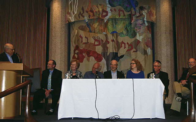 Temple Emanu-El's Rabbi Emeritus Charles Kroloff, left, welcomes panelists at the launch of the temple's new book, from left, Rabbi Arnold Gluck, Helaine Gersten, Rabbi Lennard Thal, Rabbi Eric Yoffie, Rabbi Mary Zamore, Steven Barcan, and Rab