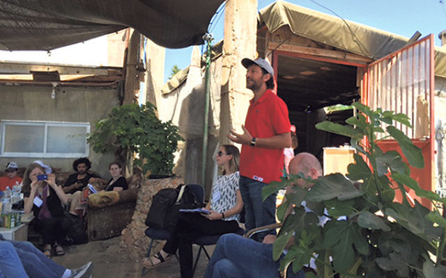 Ali Abu Awwad, founder of Jubur-Roots, whose mission is to develop nonviolent Palestinian leadership, addresses the Encounter participants.