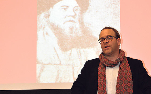 Gender studies expert Yakir Englander, showing a picture of the hasidic master the Baal Shem Tov, studies the fervently Orthodox Jewish community he left behind.