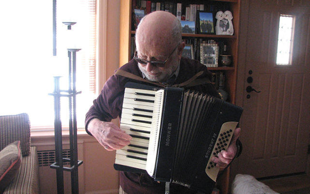 Peter Engler playing the accordion Fritz Adler gifted him in Shanghai when Engler celebrated becoming a bar mitzvah. PHOTO BY JOHANNA GINSBERG