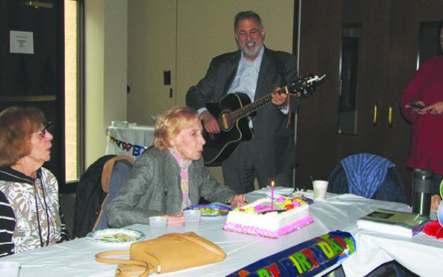 Ethel Lerner, serenaded by Rabbi Moshe Rudin, celebrates her 100th birthday at Adath Shalom. Photos by Johanna Ginsberg