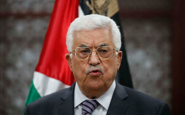 Palestinian Authority President Mahmoud Abbas speaking at a news conference after the arson attack, allegedly by Jewish extremists, that killed a Palestinian toddler in the West Bank city of Ramallah, July 31, 2015. (Flash 90)