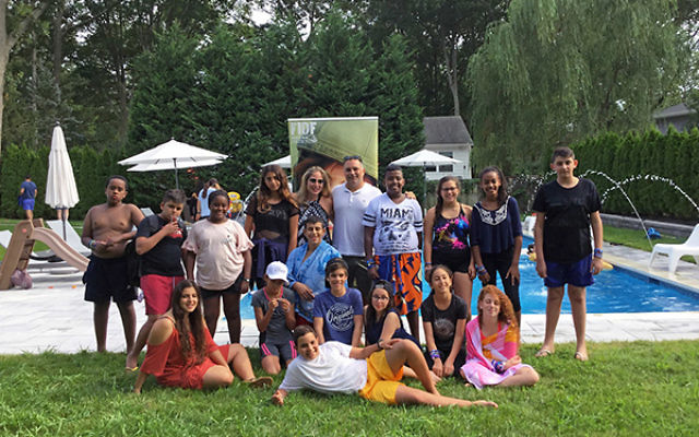 In lieu of a proper bar or bat mitzvah, Friends of the Israel Defense Forces took Israeli children who have lost parents or siblings in uniform on a 10-day trip to the U.S. Daniel and Paula Marcos invited the group to a pool party at their Oakhurst home.