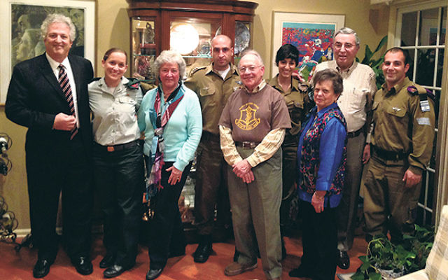 At the Monroe event are IDF soldiers, organizers, and hosts, from left, NJ FIDF director Howard Gases, Brit, Frieda Posnock, Eliran, Eddie Thompson, Elle, Dorothy Thompson, Leonard Posnock, and Tal. The soldiers are not permitted to use their last names.&