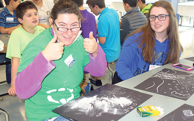 """Dina Friedman gives Friendship Day at JKHA a """"thumbs up"""" as Jessica Klein looks on."""