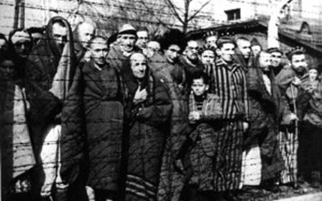 Roman Ferber as a child, with fellow inmates at Auschwitz.