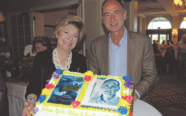 Martin Fletcher, with book club chair Marlene Cohen and the cake made to welcome him to the Green Brook Country Club, where he spoke about his latest novel and Israel's recent war with Hamas.