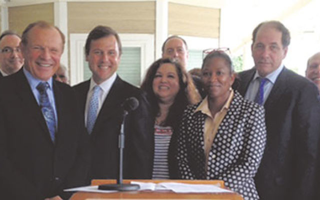 At the Food Stamp Challenge launch on Sept. 8 at Jewish Family Service of Central NJ are, from left, State Sens. Raymond Lesniak and Tom Kean Jr.; NJ Assemblywomen Annette Quijano and L. Grace Spencer; State Sen. Joseph Vitale; Tom Beck, executive directo