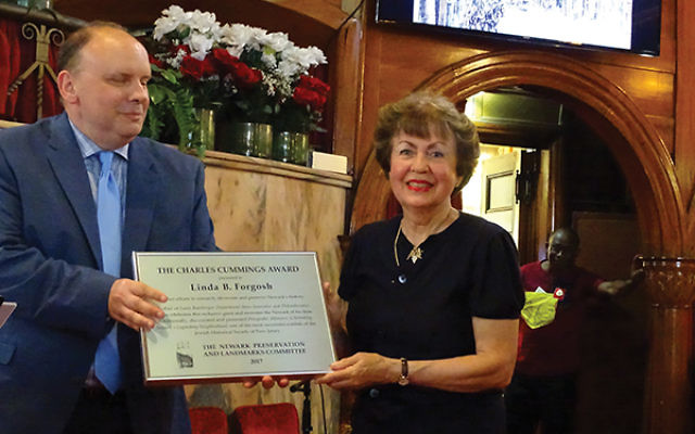 "Newark historian and librarian Thomas Ankner presents the Charles Cummings Award to Linda Forgosh, executive director of the Jewish Historical Society of NJ, for ""her efforts to research, showcase, and preserve Newark's history."" Photo b"