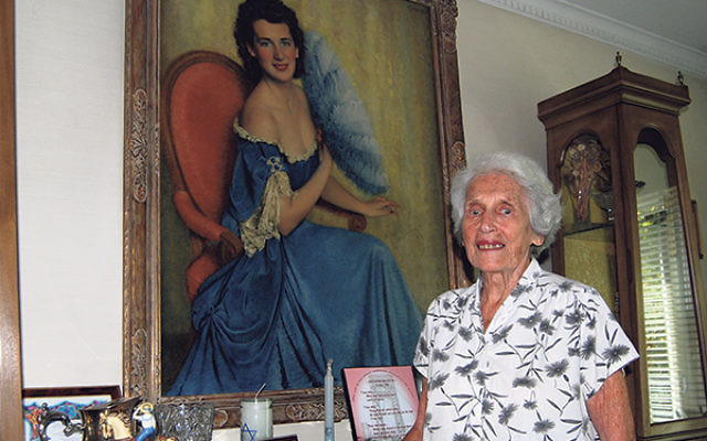 Anitta Fox shows the portrait of her that her father Fred Boyko painted in 1951, his last work before he died.