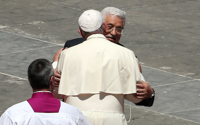 Pope Francis greeting Palestinian Authority President Mahmoud Abbas as the pope leaves St. Peter's Square at the end of a canonization ceremony in Vatican City, May 17, 2015. (Franco Origlia/Getty Images)